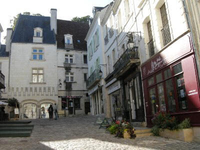 cobbled street in Loches showings some of the shops