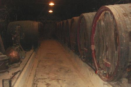 Wine barrels in the cave at Chateau de Breze in the Loire Valley