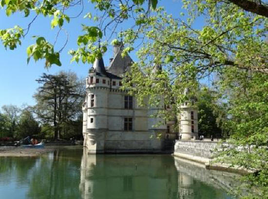 The small turrets of Chateau de Azay-le-Pideau suspended over the water of the river Indre