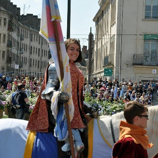 Joan of arc leads the parade at the festival in Orleans France